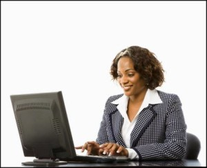 black business woman at laptop